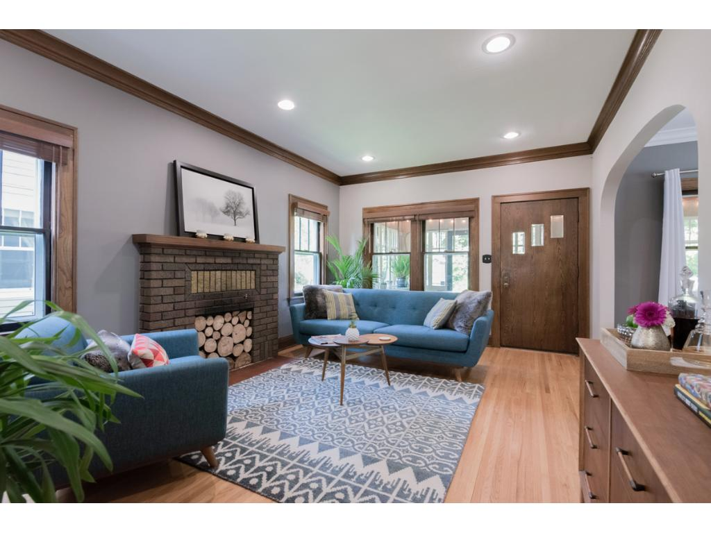 """Find yourself right-at-home in this beautifully updated 1920's charmer! Inviting indoor spaces include 9' ceilings, updated lighting, original wood work, hdwd flrs, wood fplc & 3 season front porch. Open living area boasts a kitchen w/granite counters, SS appls, 50"""" cabinets, 5-burner gas range w/vented hood, breakfast bar & copper sink. 4 BRs include large UL master w/built-in wardrobes. Quiet neighborhood is blocks from 50th & France, 50th & Penn, Linden Hills, Lake Harriet & Minnehaha Creek!"""