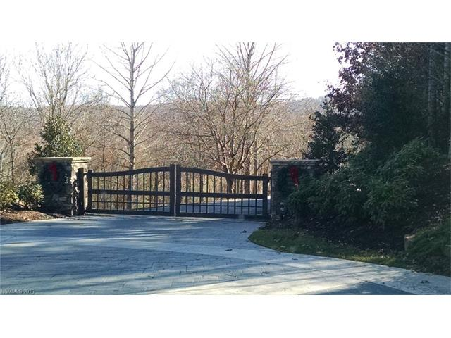 STUNNING GATED COMMUNITY WITH OVER 400 ACRES & 200 OF THOSE ACRES IS GREEN SPACE & WALKING TRAILS AND ONLY 79 LOTS (VERY PRIVATE) . YOU WILL THINK YOU ARE IN THE NATIONAL FOREST YET ONLY 8 MILES TO HENDERSONVILLE MAKES THIS COMMUNITY CONVENIENT. AMENITIES INCLUDE CLUBHOUSE WITH FITNESS ROOM, MAIN POOL, KIDDIE POOL, JACUZZI, HIKING TRAILS, FISHING TROUT POND & A HUGE WATERFALL LIKE NO OTHER. COMMUNITY CONSISTS OF BEAUTIFUL HIGH-IN HOMES. SEE Oletafalls.org for more info....BRING ALL OFFERS