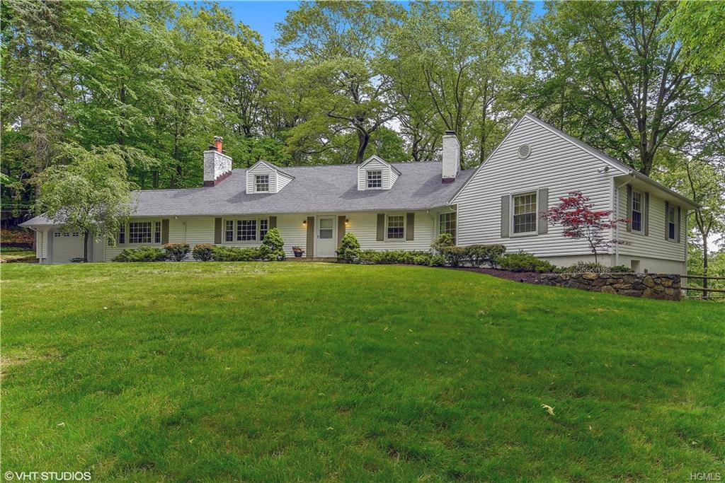 Seller's pride of ownership shows. Great curb appeal as you approach this wonderful, spacious 5 bedroom custom sprawling ranch with extended lower level in Windmill Farm, Armonk in Byram Hills School District. The Windmill Club season has just begun-come see why this community is so special. MEC included ($40K value). Two master suites to choose from. The downstairs Master Suite includes a large changing room with plenty of closet space & a soaking tub with a separate steam shower. This home is perfect for entertaining with an open floor plan & sliders to a large two-tiered, very private deck overlooking gorgeous woods. Eat-in-kitchen with large granite peninsula open to family room with curved ceiling. Very spacious open concept dining room open to living room with built-ins & marble fireplace. Additional special features include: hardwood floors, new siding, new roof & many new windows from 2010. Family/Rec Room downstairs with FP & pool table included.