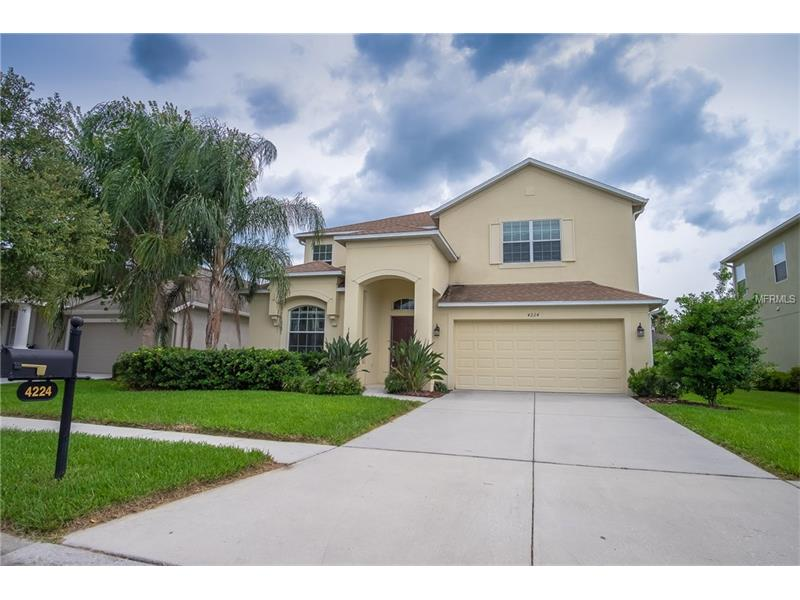 """Beautiful Standard Pacific Venetian POOL home in gated Crosswinds community in Seven Oaks! 5 bedroom 3 bath and huge 2nd floor game room. The kitchen showcases beautiful granite counter tops & back-splashes, upgraded stainless steel appliances, 42""""cabinets w/plenty of storage storage, plus a huge walk in pantry! The family room looks off the kitchen and has view of the pool outside. There is a fifth bedroom and full bath for that perfect guest or in-law space and leads out to the pool area. Beautiful screened in lanai opens to the pool with water feature with carefully designed plants to ensure privacy.  Big master is upstairs with tray ceiling and with a spacious master bath and upgraded to include his and hers closets. 3 other bedrooms and another bath upstairs and one of the largest game rooms you can get.  This home is ready for new owners and all the appliances will stay with the home. Don't overlook this great opportunity for your new home in the highly desired community of Seven Oaks with resort level amenities. Make your appointment to see this home today."""