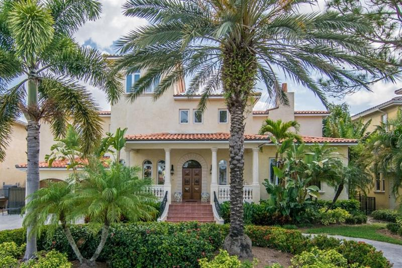 Designed and Inspired by the Grand Villas of Italy, this Magnificent Mediterranean Masterpiece is majestically set overlooking the protected dockage of Pirates Cove and the open waters of Old Tampa Bay.   Built in 2000, this opulent European Showplace was built for entertaining on a grand scale yet balanced with intimate spaces for daily family living.  Elegance and luxury abound in the architectural details starting with the impressive  22 foot ceiling in the foyer. The state of the art kitchen is a chef's paradise featuring hand carved cabinetry and professional grade appliances and open to the large family room with wonderful views of the pool and water.  Additional features include a first floor master suite, loft area perfect for the home gym, 2nd floor laundry room, outdoor kitchen area, limestone travertine and hardwood flooring, gas appliances including a new tankless hot water heater, exquisite built-ins, and three custom fireplaces.   Savor the sunsets of the open bay 365 days a year from the third floor bonus tower room.  Situated in historic Beach Park, you are minutes away from fine dining and entertainment, top public and private schools, luxury shopping and downtown.  For those who appreciate the setting, the address, and the home that others dream of, call today for your private appointment.