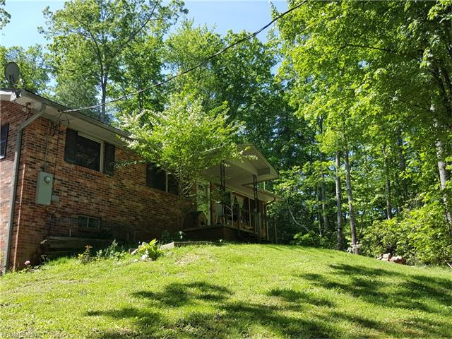 Located in Blue Ridge Estates must see this 3 bedroom brick ranch with 5 acres of land.   Woodstove insert and deck. Wooded lot with mountain laurels and stream.  Private setting.  Easy drive to Flat Rock or Hendersonville. Occupied by tenant. Showing requires 24 hour notice.