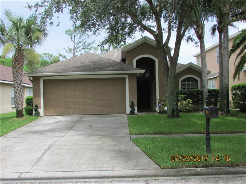 Amazing, Turn key home in Westchase! This beautiful home features an open floor plan and was completely remodeled in 2013! The gourmet kitchen includes granite counters, wood cabinets, Frigidair Stainless appliances to include a gas range. The master suite has a large walk-in closet and lovely bathroom with oversized garden tub, seamless glass shower, double vanities with granite counters. Plus hand scraped hardwood floors, porcelain tile floors, pottery barn chandeliers, wood blinds and an oversized patio with screened lanai. An immaculate and well maintained home close to everything!