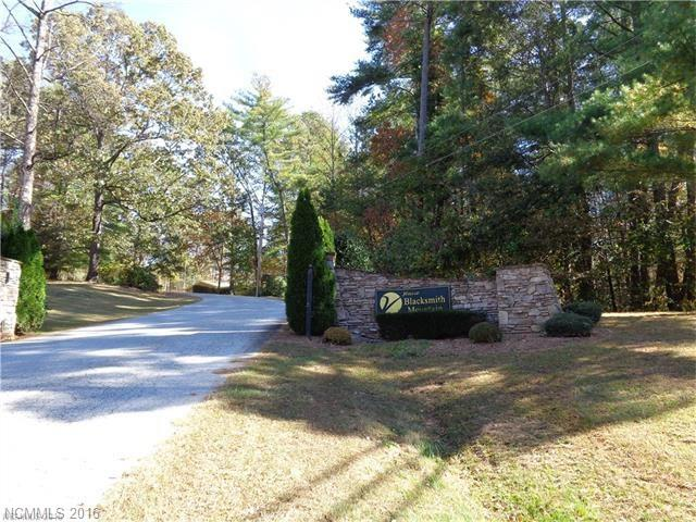 Unique, one of  kind cul-de-sac, private estate home-site in beautiful Blacksmith Mountain! Year round mountain and long range views. Community amenities include clubhouse with event room, pool, fitness center and stocked pond. Underground electric. 4BR septic permit. City water available. 15 minutes to DT Hendersonville.
