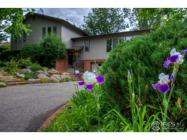 Enchanting park-like landscaping and view of the lake highlight this solidly built, lovely home!  Seller built this tri-level home in 1974 and has cared for it lovingly.  Nice flow to floor plan. Gorgeous sun room with a wraparound deck adds to feel of great outdoor living space,+ terraced back yard with beautiful rock work and old growth greenery. Huge basement area with tons of storage, 779 sq ft garage. Neighborhood association includes private park, lake with boating up to 10HP.