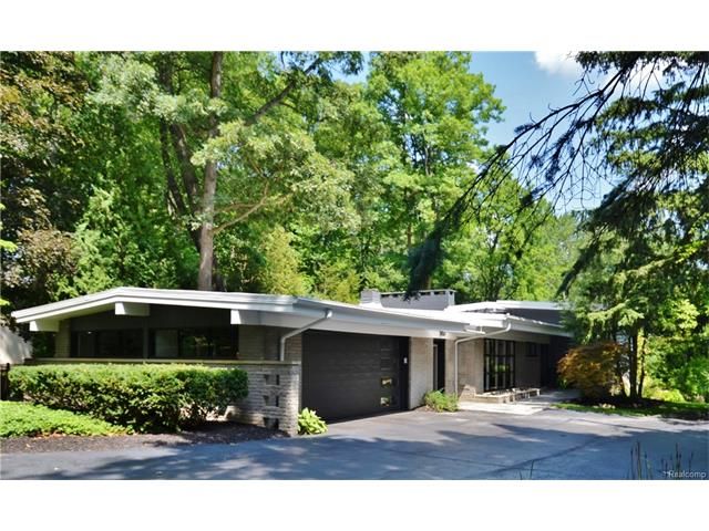 Phenomenal mid-century modern home w/ contemporary additions situated on half+ acre. Wonderful example of Frank Lloyd Wright inspired architecture.  Home completely renovated in 2016 combining best of modern building trends w/original integrity of brick, glass & wood. With easy & natural flow between living areas, the 3800+ sq ft residence benefits from abundance of natural light & high end finishes resulting in sophisticated & comfortable home.  Beautiful kitchen w/ custom Scavolini cabinetry, Miele/Thermador appliances, honed granite island & quartz counter tops.  Gracious master with luxurious spa bath features sleek fixtures & marble tile euro-shower. Enjoy the tranquil setting from fabulous screened balcony off master suite.  Two additional bedrooms & a truly stunning full bath complete upper level. Imported porcelain graces LL & adds to its richness along w/ a beautiful gas fireplace & custom lighting found throughout. Fenced patio off LR/DR provides serene wooded setting.