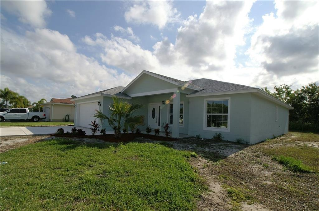 This new home is waiting for you! It has all the bells and whistles. Offering 3 bedrooms, 2.5 bathrooms with 1,890 sq.ft. of living space. Upgrades include: impact windows, wood tile floors, granite countertops, steam shower in master with dual shower heads, large walk-in closets, washer, dryer and much more. This is truly a must see so don't let this one get away!