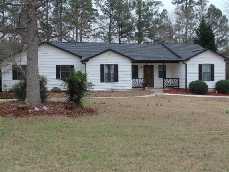 Location, Location, Location!  Updated home with Architectural Roof, Maintenance Free Vinyl Siding, Screened in Backportch, Fenced Backyard, Out Building and a Second Driveway for your RV or Boat!  This home has it all and then some. Split Bedroom Floorplan with Living Rm and Kitchen Open. Separate Dining Rm or Bonus Rm. Side Entry Garage. Located near all the new Shopping/Restaurants/Theater/ETC in Bethlehem off Hwy 316.  Showings after 4pm and weekends only! Qualifies for 100% financing!