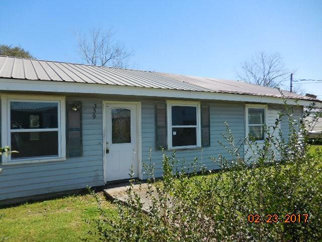 Ranch style home with 3 bedrooms on  a slab foundation.