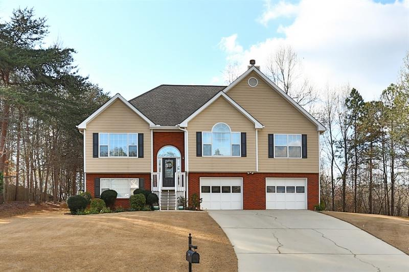 Welcome home to your spacious 4 bedroom, 3 full bathroom home located in a cul-da-sac close to Lake Lanier. Upstairs includes a large living room and dining room overlooking a large private backyard. The updated kitchen offers stainless steel appliances, granite countertops and upgraded backsplash. Downstairs includes a large bedroom with private room right off the oversized garage and storage room! Community amenities include a pool and playground! Great location convenient to shops and restaurants!