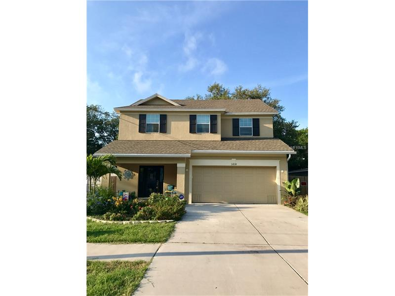 """Welcome to your beautiful new family home. Tastefully decorated and located in this highly desirable South Tampa neighborhood. Some of the many hightlights of this home include: 9'4"""" ceilings on first floor, gourmet kitchen with granite and stainless steel appliances, great room, covered lanai opening up to your beautiful large fenced in back yard. Beautiful flower gardens including a butterfly garden at the front of your new home.There are 4 raised gardens 3x9 & 4x9 and are one year away from organic certified complete with Florida red worms and Florida organic materials.   Enjoy relaxing and restful time in your spacious master suite with tray ceiling and an oversized walk in closet, Spa tub with separate shower. Three additional spacious bedrooms, full bath and a laundry room will round out your second level. Great location, close to restaurants, shops, A-rated high schools, and MacDill Air Force Base."""