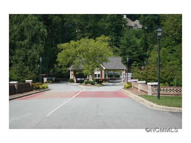 Past the gatehouse and inside Carriage Park you will notice quickly how beautiful Henderson County is.  The northern view from this lot could be yours to enjoy from every room in the house.  Lots of native flora. Tennis courts, indoor pool, walking trails, a fire sub-station at the top of the mountain, and clubhouse for special activities. Convenient to shopping, dining and golf. This is truly a must see.