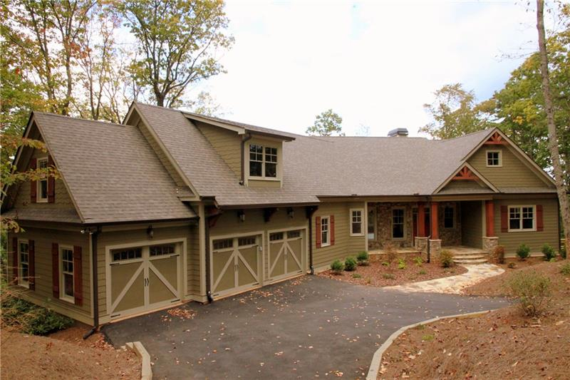 Executive home in sought after Wildcat neighborhood of Big Canoe. Home feat stunning kitchen w/Thermador appl, granite, huge island/bfast bar, view to fam rm w/stone fireplace & screened in porch w/fireplace. Mstr suite on main w/custom bath & walk in closet. Main has addtl bedrm & full bath. Terrace level has 2 addl lg bedrooms each w/full bath, a family rm w/stone fireplace & patio access. Home has tons of storage space that could be used for safe rm or wine cellar, unfinished bonus rm stubbed for bath located over 3 car garage perfect for in-law suite or hm office.