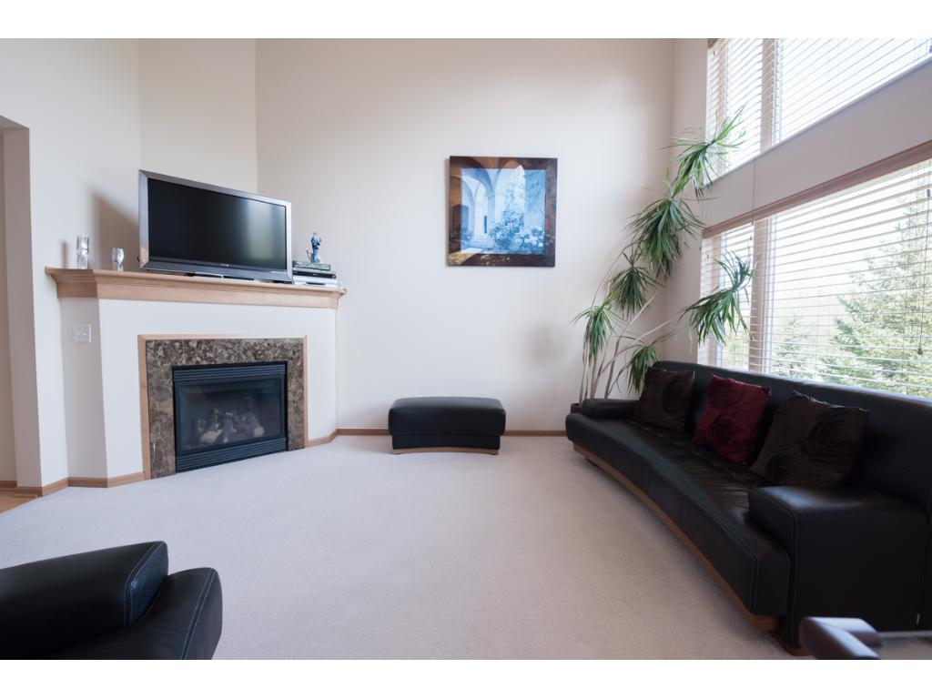 """Meticulously maintained & spacious townhome w/upgrades thru-out! Dark maple trim, Hunter Douglas window treatments & recessed lighting. Foyer w/engineered wood flrs & 1/2BA. Kitchen w/brand new SS appls,42"""" cabs, good storage & breakfast bar. Living rm w/18' ceiling & gas fplc w/granite surround. Slider off dining to deck w/pond views! Main lvl laundry. UL w/3BRs incl large Master suite w/walk-in & private BA. LL finished in '17 w/4th BR, 3/4 BA & family rm. Walk to shopping, restaurants & more!"""