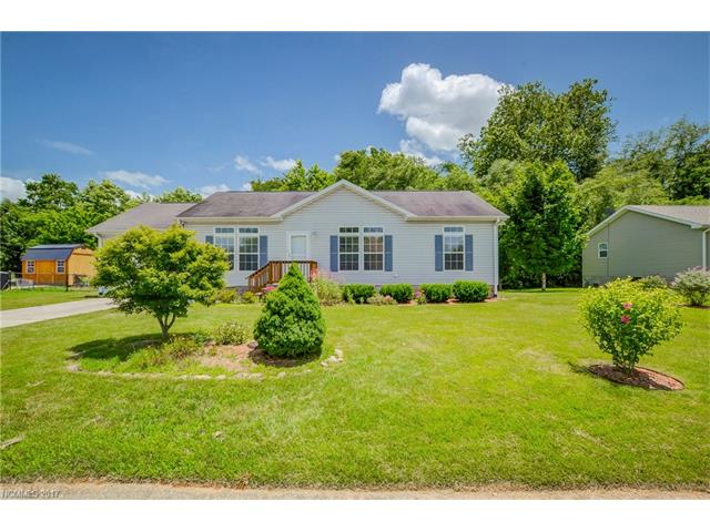 Wonderful 3 BR/2 BA home on cul-de-sac in Greens On Hoopers Creek subdivision. Level front yard w/elegant landscaping. Roomy LR w/Gas Log FP is open to DR. Galley style KIT w/tons of storage & gas range. Spacious MBR, MBA & walk-in closet. Split BR's are opposite side of home from MBR. Laundry is conveniently located between the garage & KIT. 1 car garage has loads of storage. Has fenced-in back yard & deck is a place to relax at the end of the day. Convenient to Asheville & Hendersonville.