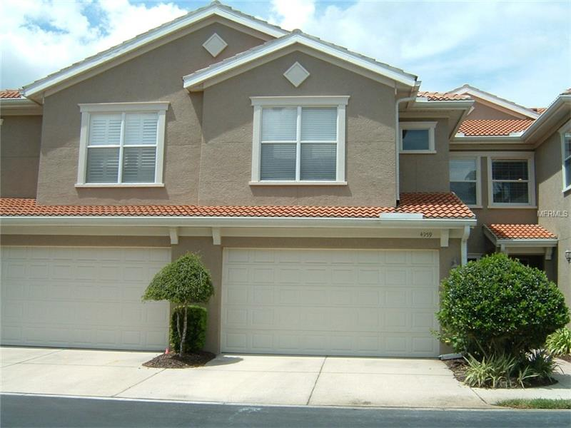 """**Maintenance Free Living in Tampa Palms**Beautifully Maintained Townhome in Palma Vista**Kitchen Features 42 Cabinets GRANITE Counters and Breakfast Bar**HARD WOOD Flooring on the First Floor**ALL NEW CARPET Upstairs and Master**FRESHLY PAINTED**3 Beds 2.5 Baths**Two Car Garage**Master is Downstairs With a Sitting Area**Walk-In Closets in ALL Bedrooms**HUGE LOFT**Perfect For Office or TV Room**New Washer**New Microwave**20"""" Diagonal Tile in Wet Areas**Fans in All Bedrooms**SERENE Pond View**Enjoy the Meticulously Maintained Grounds**Two Community Pools**Fitness Center and Clubhouse**Located Minutes From USF, Moffit, Florida Hospital, Busch Gardens, MOSI, Restaurants and Shopping**Easy Access to I-75 and I-275**Monthly Maintenance Includes Exterior Building Maintenance**Lawn Service Pool**."""