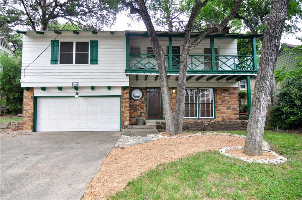 Charming 3 bedroom 2 bath home with hardwood throughout in West Kessler near Stevens Park Golf Course with attached two car garage. Home is situated on a heavily treed, elevated lot.  Enter to spacious living area with fireplace and a bedroom with full bath downstairs.  Downstairs bedroom features bonus office area.  Decorative tile staircase risers lead upstairs featuring a cozy kitchen, dining room, two bedrooms and updated hall bath.  Large master upstairs features spacious balcony overlooking front yard. Nice deck and storage building in back with plenty of yard.
