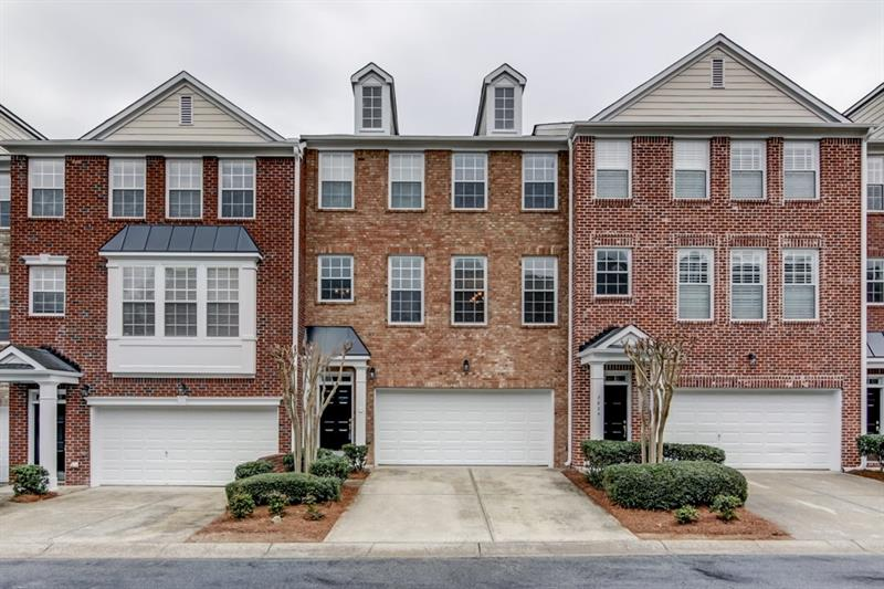 Beautiful three story townhome in popular Chattahoochee Bluffs! Kitchen features ample cabinet space, pantry, and breakfast bar. Open family room with custom blinds boasts gas fireplace. Separate dining room is perfect for entertaining! Hardwood floors on main. Master suite includes a vaulted ceiling, large walk-in closet, and master bath with double vanity, jetted tub, and separate shower. Two additional upstairs bedroom well-sized and bright. Laundry up! Lower level flex space with half bath is ideal for a media room, home office, and more! Other features include newer top of the line zoned heating and cooling system and fresh paint throughout! Two car garage! Wonderful community amenities include a pool, clubhouse, gym, and gated access. Amazing ITP location backing up to Chattahoochee National Forest and trails with easy access to interstates, new Braves stadium, and Vinings/Sandy Springs/Buckhead! Low HOA! Refrigerator, washer and dryer included!
