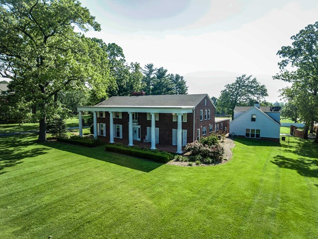 Priced below current appraisal. All you ever wanted on 1.5 acres in the center of Coookeville TN! Elegant, renovated, colonial. 5531 sq ft in the main house has room to spread out for entertaining and a large family with 5 bedrooms, 5 full baths, half bath. Modern conveniences with the nostalgic features maintained such as the stunning entry foyer and stately staircase to the upper level. Main level master with fireplace and modern bath. The brand new sunroom overlooks the back yard and swimming pool. Modern kitchen with butler's pantry, large laundry room, many bonus areas to accommodate studying or home offices.