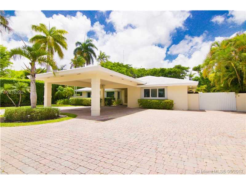 Located in the exclusive private gated community of Bay Point, this pool home offers a huge 18,731 sq ft lot on a quiet corner cul-de-sac. Over 3,500 sq ft of light & bright interior w/ split open floor plan & roomy master suite. French doors open to tropical pool/Jacuzzi area including separate pool house w/ bar, sauna & bath makes this home perfect to entertain family & friends. Great central location, close to Design District, Wynwood, Downtown, Beach, Cushman school, airport, & Medical center.