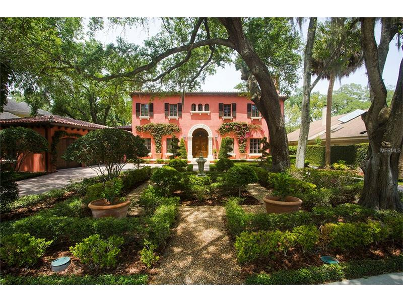 A taste of Italy comes to South Tampa! Incredible Rustic Italian Country Villa situated on over 15,000 sqft of manicured grounds/gardens overlooking Swann Park in the heart of Beach Park. The current owners lovingly designed & built the home with the highest quality materials & finishes. Beautiful entry & gallery features cloister vaulted ceilings, aged, chiseled & brushed travertine floors leading into the formal dining & living rooms with pecky cypress ceiling beams. The living room includes a gas fireplace with Italian renaissance hand carved travertine mantle. Chef's kitchen with high quality cabinets, center island w/ seating, granite countertops, 8 burner Wolfe gas cooktop & griddle + double ovens, Sub-Zero refrigerator, warming drawer & 2 sinks overlooking the breakfast area & family room. The family room features aged hickory plank floors & multiple sets of french doors leading out the lusciously landscaped backyard & pool area. Downstairs also includes the master suite & handsome library. The spacious master suite features 2 walk-in closets, vintage style soaking tub, walk-in shower & dual vanities w/ nickel fixtures. French doors in the master open onto the covered porch that overlooks the wonderful gardens. The additional 4 bedrooms are located upstairs along with a large loft area perfect for relaxing. 12 sets of French doors open out to the incredible geometric gardens & heated pool with an automatic pool cover. Detached cabana with outdoor kitchen, 1/2 bath & exterior pool shower.