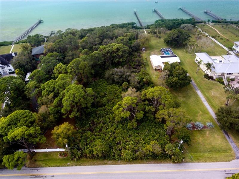 OVER 2-ACRES OF LAND ON LEMON BAY!  This is a great place to build your dream home on the mainland with nearly 200-feet on the bay.    There is plenty of space to accommodate all of your plans.  The location is close to area beaches and the center of town is approximately 5-minutes away with shopping and dining options.