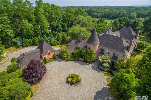 Majestic French Normandy Brick Manor, Formerly The Summer Retreat Of The Duke And Duchess Of Windsor. Long Drive With Gated Entrance Leads To Expansive Views Of 4+ Acres With Walled Gardens And Specimen Trees.  This Exceptional Residence Offers Wonderful Entertaining Rooms, Including Updated Gourmet Kitchen With Bkfst Rm. Guest Quarters Above 4 Car Heated Garage.
