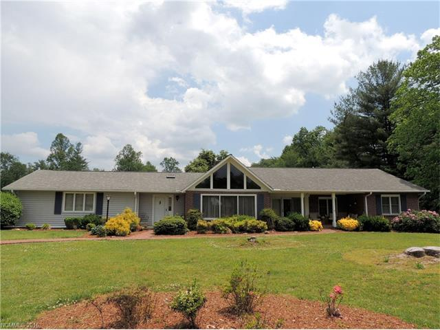 SOLD AS IS. SELLER TO MAKE NO REPAIRS. SEE ATTACHMENTS. LEVEL LAND ACROSS FROM ETOWAH GOLF COURSE WEST NINE. 2 FIREPLACES SEPARATE SUITE FOR EXTENDED FAMILY. KITCHEN WITH GREAT CABINET SPACE, OPEN TO DEN. SELLER SAYS HARDWOOD UNDER CARPET. CAROLINA ROOM NOT COUNTED IN SQUARE FOOTAGE. FOUR GARAGES FOR THE COLLECTOR . PROPERTY LINE RUNS IN FRONT OF BARN TO FLAG ON RIGHT HAND SIDE, WILL NEED NEW SURVEY RUN ON BACK LINE. 