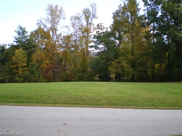 Homesite located in Sherwood a community in the Historic Flat Rock area.  The gentle topography of the lot offers an excellent home site tucked in the hardwoods overlooking the communities open park/green space.