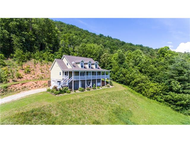 Motivated Seller!  Make an offer! Desirable Fletcher/South Asheville Location!  Don't miss the views from this charming mountain home.  The home features 3 bedroom 3 baths, full unifinished basement with 2 car garage and room to expand!  Additional office space on main level could be used as another bedroom.  Master with en-suite on main level.  Upper level features 2 bedrooms, 1 bath with computer niche.  Enjoy year round views from the rocking chair, covered front deck!
