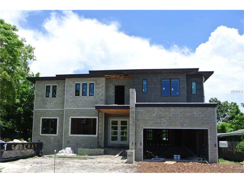 Under Construction – Estimated Completion Sept. 2017. A beautiful example of Modern Transitional Architecture by Madison Construction, this Davis Islands 5002 heated SF, 5 bedroom, 5.5 bath home will feature luxury finishes throughout. Enter the foyer to views of a spacious great room with floor-to-ceiling atrium doors overlooking the lanai and saltwater pool. The gathering room seamlessly opens to the chef's kitchen featuring dual islands, Wolf and Sub-Zero Appliances, sleek cabinetry and a walk-in pantry.  A generous dining area, home office, guest suite, powder bath and mud room complete the first floor. Upstairs find a master retreat with dual walk in closets and a luxury master bath.  The 2nd floor includes a flex/game room, private bedroom suite, two bedrooms that share a Jack-n-Jill bath and a spacious laundry/craft room.  Enjoy superior quality construction and finishes with a floor plan that's ideal for today's lifestyle!