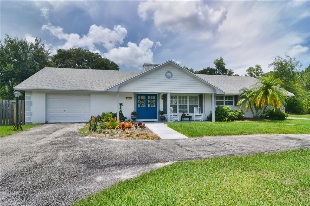 "Nestled on a huge lot is this 3 bedroom, 2 bath home with bonus room on a private , corner lot, on a lake. Open floor plan for easy entertaining. Relax in your favorite chair while you watch Florida's nature sing in the back yard. Perfect for the growing family or if you need a place for extra family to stay. The detached guest house has two kitchens, laundry room, storage and bedrooms for the extended family. Enough parking to have an RV, boat and your daily cars. Attached garage with main house. Less than a 1/4 mile stroll to Palm City Elementary.  Neighbors only on one side. The rest can't be built on. Located close to shopping, waterways, major roadways, beaches, ""A"" rated schools."
