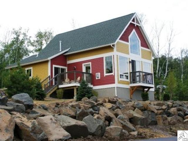 Newest addition to Cove Point Lodge, new fully furnished cottages. The cottages all feature extra large windows to provide and expansive view of Lake Superior. Paved roads, landscaped lots, and rental revenue to offset expenses.