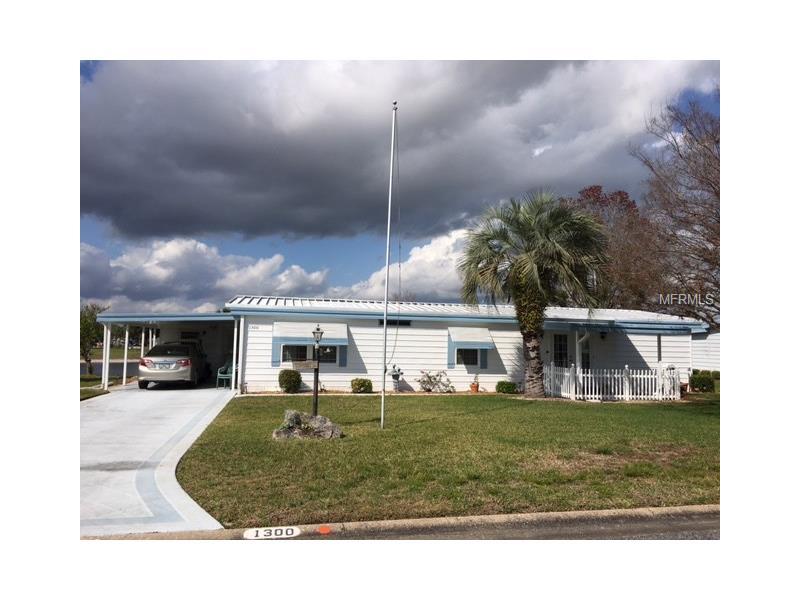1300 SUN MEADOW LANE, GRAND ISLAND, FL 32735