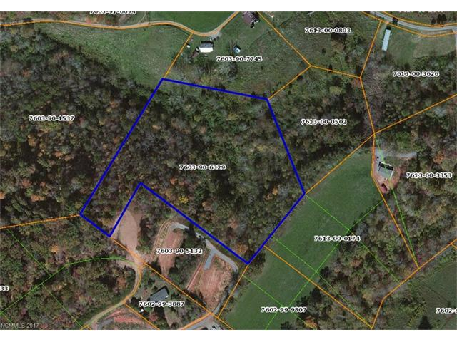 Acreage near Whittier off Quin Holcombe Road.  Deeded right of way from property running along a ridge to the end of Quin Holcombe Road.  Could be many uses.  Timber, tree farm, pasture (with tree cutting and improvement), or sub-divide.