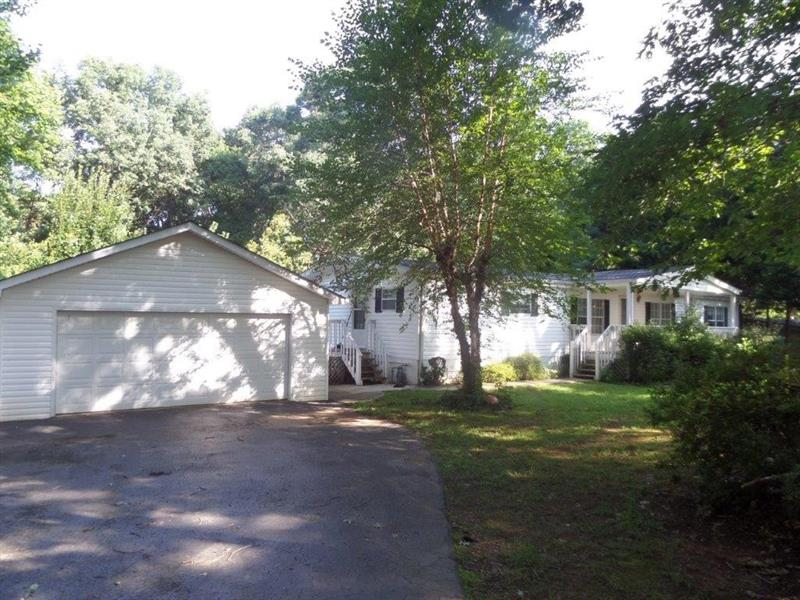 This home is located on a 1.85 acre wooded lot with lots of privacy! It has 3 bedrooms, 2 baths, large garden tub, double vanities, oak cabinets, central heat & air, covered front porch, fireplace and more! The exterior has a large detached 2 car garage, garden area, fruit trees, and beautiful Oaks for comfortable shade.