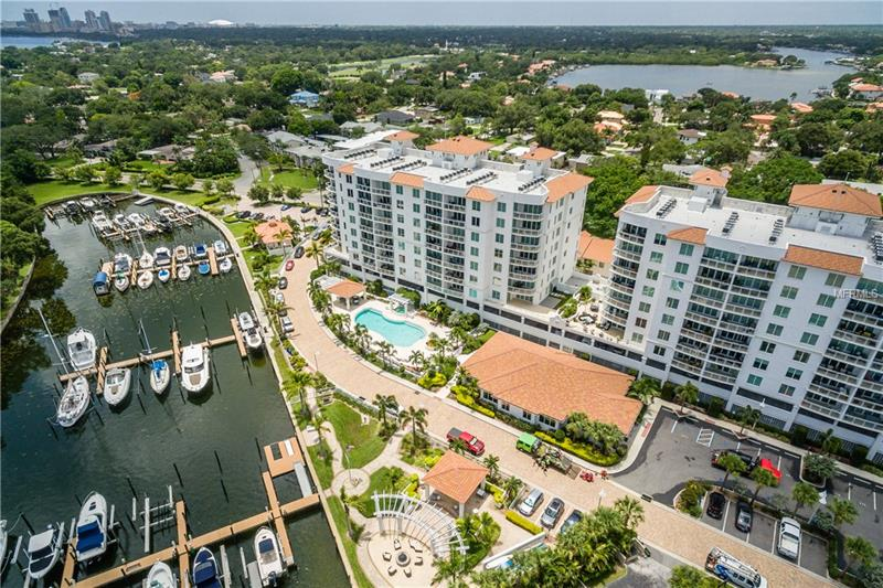 Stunning Snell Isle Waterfront Condo! Let your private elevator take you home to peaceful open concept living.  A large gourmet kitchen with state of the art appliances and expansive granite counter tops flows into a large living area perfect for entertaining. Floor to ceiling windows and doors let in the Florida sunshine in throughout the day.  A large private balcony is perfect for coffee in the morning or a glass of wine in the evening. Your master retreat will greet you with the beauty of the sun rising over the water each day. The custom closets and grand master bath can't be beat. A private second bedroom will comfortably accommodate guests. This home also offers a large bonus area with custom built-ins perfect for an office space. The possibilities are endless. The Water Club community offers luxurious amenities. A wonderful pool area, private gym, professional office area, grand entertaining space with a private kitchen for catering. And last but not least, a cozy covered veranda that sits along the waterfront with a firepit. It just doesn't get any better in Florida than that!