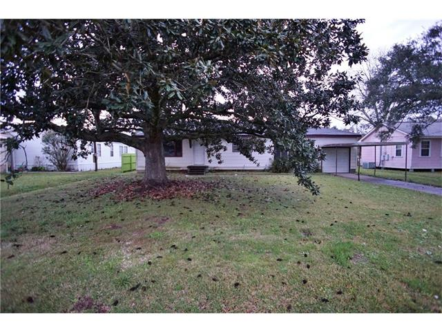 Spacious, Raised Cottage style home with large yard, covered carport and attached garage. Property can easily be used as a 3 bedroom home. Large rooms and nice sized closets. Lots of shade and a large shed for storage.