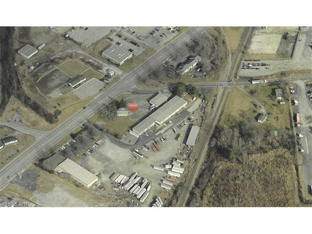"""Redevelopment opportunity in a growing commercial area of Fletcher <1 mile from the US 25/I-26 Interchange; multiple buildings have interim use or may be incorporated into redevelopment for retail, warehouse, distribution, fast food, auto dealership site, etc. Traffic-lit corner """"hot spot"""" best for national brand retail; almost entirely level site w/ high traffic exposure & street level access; site topo is conducive to redevelopment; 1 blk from Smiley's! multiple PINs; do not disturb tenants."""