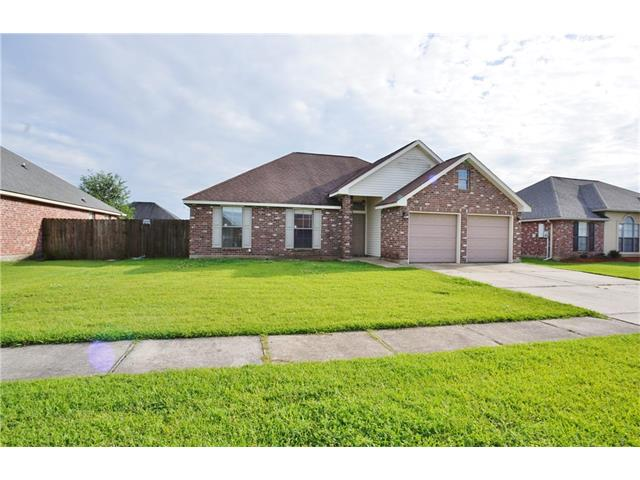 Large den with corner fireplace and vaulted ceiling, Indoor laundry area, spacious garage and large fenced rear yard. Master bath has jetted garden tub and ceramic flooring. Walk in master closet.