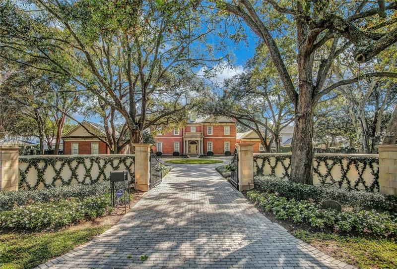 This is a one of a kind, walled and gated estate overlooking the fifth fairway of Palma Ceia Golf Course in Tampa.  Built in 2003 by Bayfair of Tampa in the classic elegance of a southern park like plantation.  Over, 40,000 square feet of expansive land, extends to the golf course and water feature; reflecting the feel of an English countryside, with all the modern state of the art technical features; including appliances, electronics and security system.  This quality estate is over the top with custom hand milled wood interiors, Indiana oolitic limestone, hand molded brick exterior.  The no upkeep limestone is on all exterior trim features; the terraces, west and east columns, windows and doors. There is 7 tear dental molding.  Under the roof line and 7 tear deep molding surround each door and window opening so no replacing of exterior wood.  The interior first level with 12 ft ceiling has molding from 7-14 tears deep in wood – over arched door openings, windows, ceiling and base boards,  The grand entrance vestibule and the interior grand hall are both of marble and the staircase is right on axis from the front west corridor to the east displaying the expansive private land and golf course views.  The three story grand hall entrance with circular soaring staircase and vaulted ceiling makes one feel so free and elegant as one rises to the 2nd and 3rd floor. There is an elevator.   SEE ATTACHMENT FOR MORE DETAILS