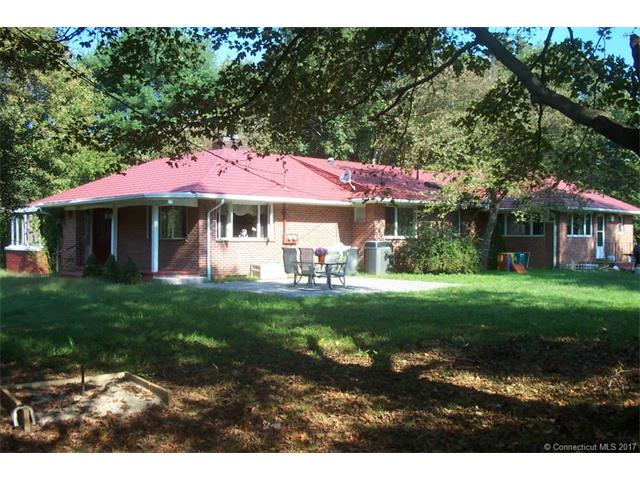 A very rare opportunity! Legal 2 family ranch with over 2600 sq./ft. on living space on one level. Open, rolling 2.6 acre lot with 275 feet frontage on (but well above) the Pomperaug River. Main portion of the home is 3 or 4 bedrooms with 2.5 baths. Large L-shaped living dining room with large picture windows, charming fireplace and pass thru to kitchen. Just outside the dining room is a sun room with wall of windows. The kitchen is very spacious with lots of work space, Corian counters, skylights and an eat-in area. The master suite has hard wood floors and an updated full bathroom with shower. This main area of the home also features a sunny bluestone patio, an office, large deck off kitchen and central air. The 1 bedroom in-law offers a separate entrance, charming kitchenette, large living space and a bedroom with full bath. Recently upgraded propane heat and hot water service this apartment. Under the living space are four garage stalls and a huge unfinished basement with potential for many uses. In the backyard is a large storage shed too. Great commuter location less than a mile from Exit 14 of I-84. This home is utilized as an Investment Property by the current owner and generates roughly $45,000 in gross rental receipts. Come see this wonderful home!
