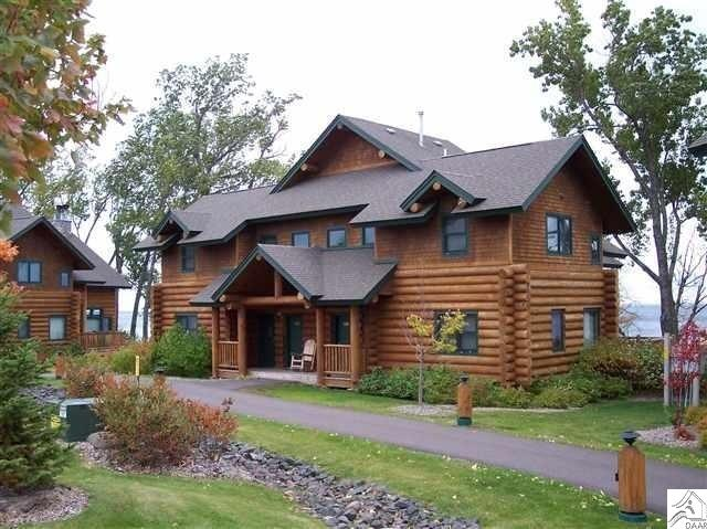 This 2000 sq. ft. luxury home is a must see!! The 1st floor offers a spacious & open floor plan with unparalleled views of Lake Superior and a fireplace in the living room. The kitchen and dining room are ideally situated for entertaining family and friends. The second level includes two bedrooms that offer lock out capabilities for flexibility and to maximize rental income. This is a high quality log home on the shore of Lake Superior, set within an upscale and established resort. It offers a maintenance free income to offset the costs of vacation home ownership.