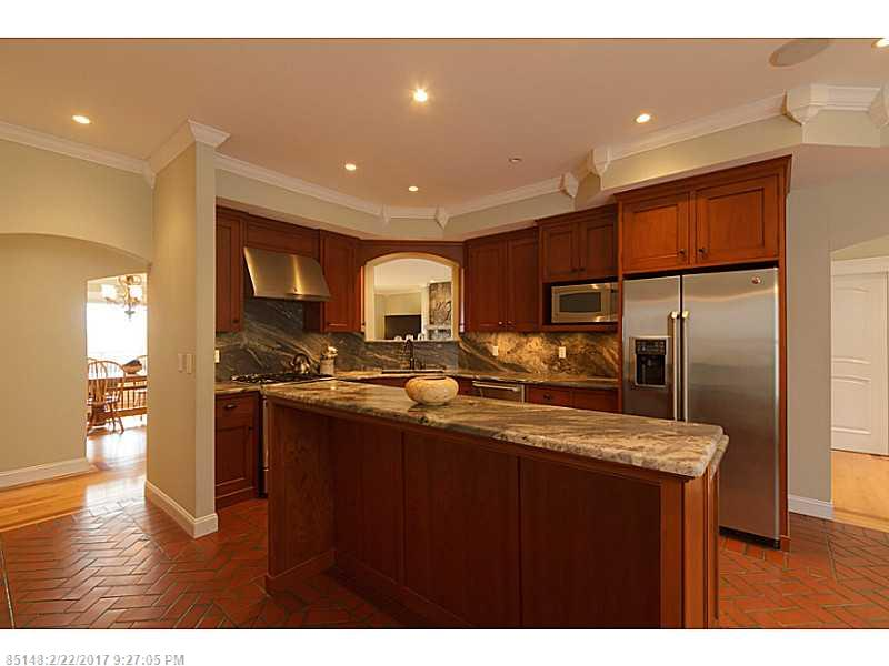 Custom home boasts westerly mountain & sunset views. 1st floor has 3 bedrooms, office & laundry rm. Kennebec cherry kitchen. Master Suite w/ lg closet. 2nd floor for entertaining, studio or in-law apt. Walkout basement w/ cistern for solar heated water.