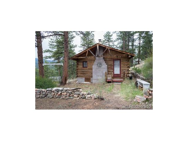 Unique secluded opportunity*Rustic* Authentic one room furnished with everything you need *LOG cabin with Privacy and magnificent mountain VIEWS, Cabin appeal surrounded by forest.and approx.*1 hour from Denver. not far from Wellington Lake* has well and septic* room to expand* storage shed, trailer and motorhome are included