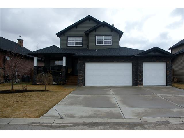 WELCOME TO THE HAMLET OF LANGDON--ENJOY SMALL TOWN LIVING WITH ONLY A 20 MINUTE DRIVE (24K) TO CALGARY--LOTS OF AMENITIES WITH SMALL SHOPS, SCHOOLS, SPORTS AND AN 18 HOLE BOULDER CREEK GOLF COURSE OWNED BY THE WINDMILL GROUP--LOCATED ON A QUIET STREET THIS HOME OFFERS OVER 2000 SQ.FT. OF QUALITY LIVING SPACE--EXCELLENT STREET APPEAL WITH A LARGE COVERED FRONT PORCH--THE TRIPLE GARAGE HAS ALL SORTS OF SPACE FOR VEHICLES, BIKES AND LANDSCAPING EQUIPMENT--HARDWOOD FLOORING IN THE KITCHEN AND NOOK, TILE IN THE MAIN FLOOR LAUNDRY, FRONT ENTRANCE AND BATHS--THE FRONT FLEX ROOM WORKS WELL FOR A HOME BUSINESS--HUGE MAIN FLOOR FAMILY ROOM WITH GAS FIREPLACE--ISLAND WITH RAISED EATING BAR--GRANITE COUNTER TOPS--THE NOOK OPENS TO A LARGE DECK WITH A NICELY FENCED AND LANDSCAPED BACKYARD WITH AN IN-GROUND SPRINKLER SYSTEM--UPSTAIRS BONUS ROOM--SPACIOUS 2ND AND 3RD BEDROOMS--LARGE MASTER BEDROOM WITH AN IMPRESSIVE 5 PIECE ENSUITE INCLUDING 2 SINKS A SOAKER TUB AND TILE FLOORING--CENTRAL A/C AND MORE. CALL NOW TO VIEW.