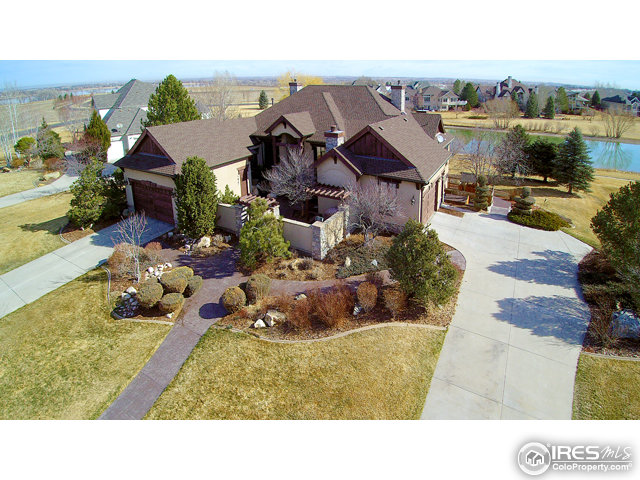 "Exquisite Eagle Ranch Estates Home.  Known as the ""Water Lily\"" house with its intricate wood detail, curved barrel ceilings, new hand-scraped Acacia floors and high end finishes throughout!  5 bed 6 bath, 4 car garage, main floor study, gourmet kitchen, cozy hearth room with fireplace.  Walkout lower level.  Lush landscaping with lake and mountain views.  Stained glass as you enter the lower level is wonderful.  Stunning courtyard at entry with fireplace, pond, waterfall and shaded dining area."
