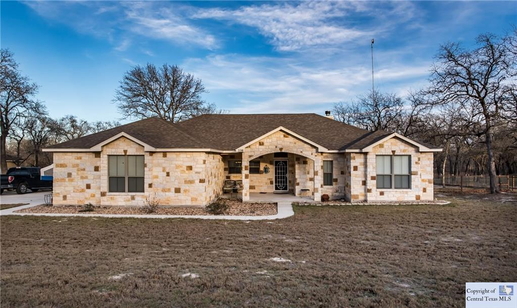 Beautiful 4 bedroom 2.5 bath home (or 3 with a study) well maintained home in the country. Wide open spaces inside and out! Amazing custom built-in's make this home one that stands out above the rest.  Large 1 acre level lot. Perfect for the growing family or the entertainer in you. Irrigation Sprinkler in the large backyard, fire pit and an over sized garage - with a half bath.