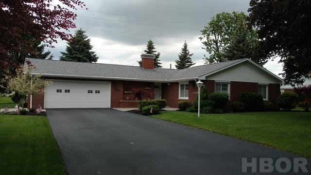 A Rooney & Associates listing. Contact Lynda Niswander at 419/421-1656 for more information. This immaculate and maintenance free ranch boasts the following updates:  GFA/CA 90% Efficiency '00;  Windows and Siding Trim '01,  New Oak Kitchen by Cavins '07;  Roof Shingles 30 YR '08; Plantation Interior Shutters '09; Add'l  Attic Insulation to R30 & Surge Protector in Breaker Box  '10; Bathrooms Updated, New Water Heater & Stainless Steel Appliances, Entry Doors and Storm Doors  '14; Garage Door Opener  & Fire Pit '15; Driveway Sealed and Lights LED '16. New Whirlpool  Drinking Water Filter System  (Kitchen Sink) '17. Landscaping installed by Roger Powell.  Utility Averages:  Gas  $57/mo.   Electric  $55/mo.  Most all floor coverings are newer.  The private rear lot  with view of the neighboring subdivision pond can be enjoyed from the covered patio and family room window. Owners are offering an ORA Home Warranty. This property was removed from the Flood Plain by an Elevation Certificate,