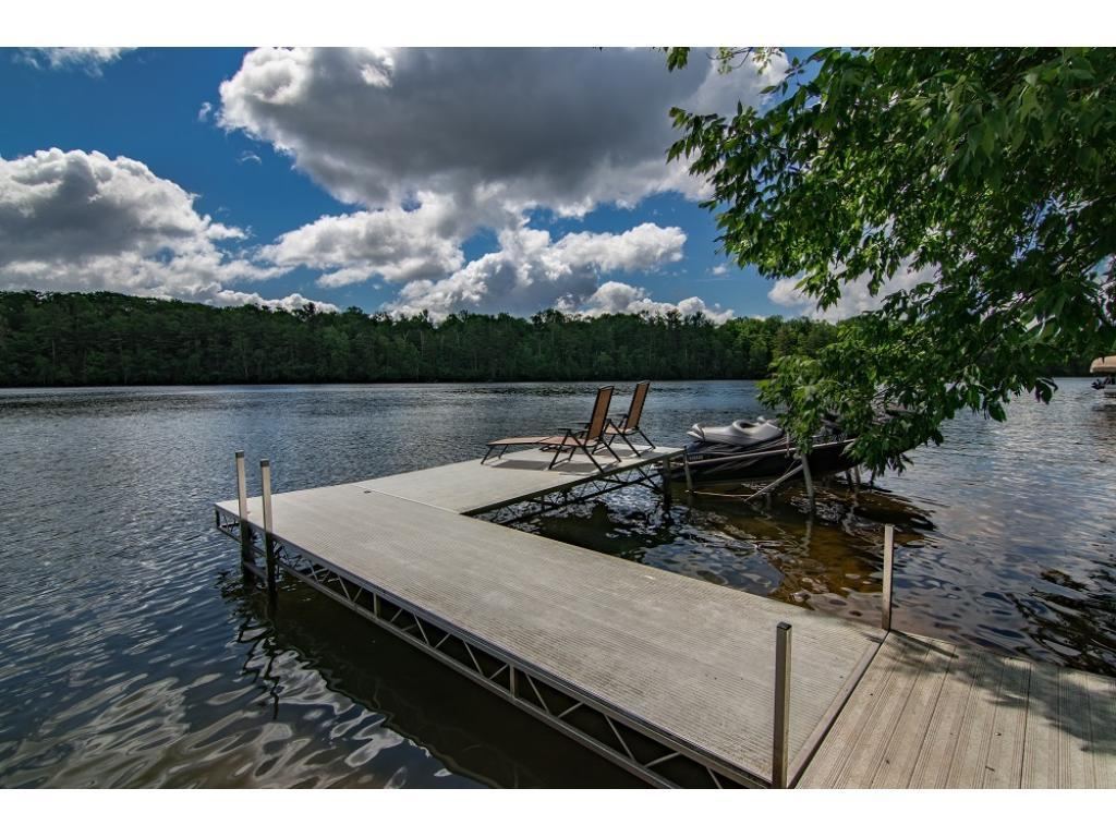 Spectacular lake home completely remodeled in 2012 w/105' of private East facing lakeshore w/tranquil views of undeveloped Boy Scout Land. Kitchen w/SS appl's & huge center island. Living rm w/exposed beam ceiling & glass French doors. Amazing 3-season porch. Updated mechanicals: new plumbing, electrical, insulation, HVAC & duct work thru-out. Freshly stained exterior, new roof & updated hardscaping & landscaping. Picturesque Long Lake w/3400 acres of exceptional fishing & recreational fun.